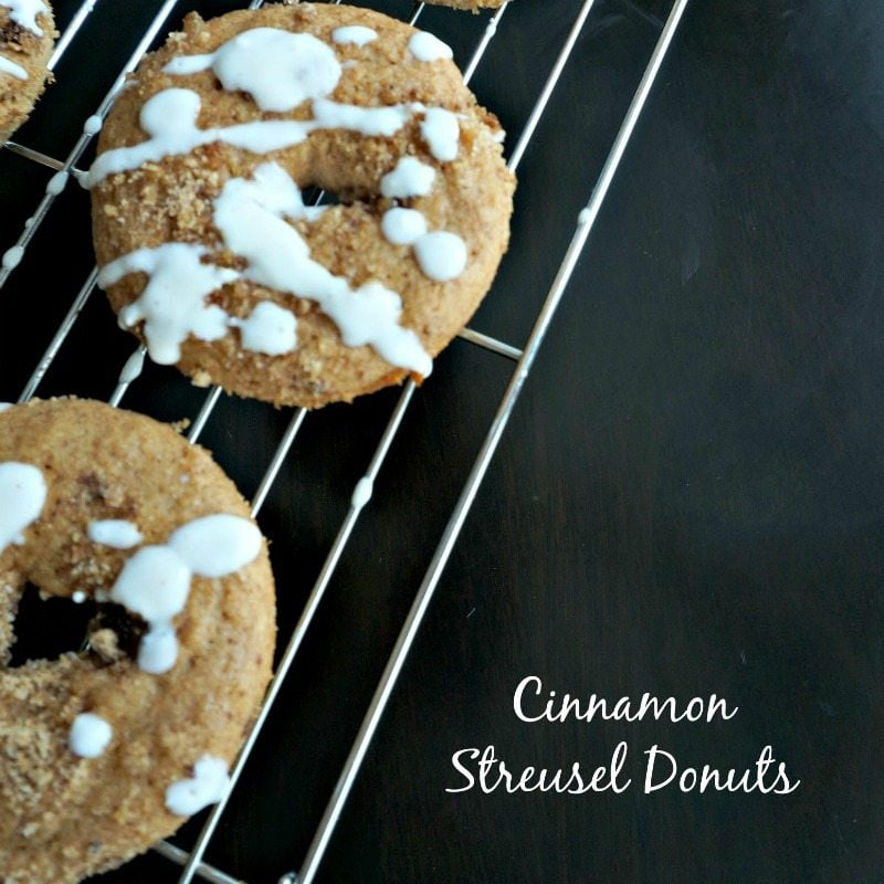 Homemade baked cinnamon donuts with cinnamon streusel and a cream cheese glaze are not only EASY to make, but they are ridiculously delicious and a perfect treat to start your day!
