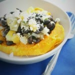 Black beans and feta are tossed with a fresh fruit salsa, making the perfect topping to a baked sweet potato.