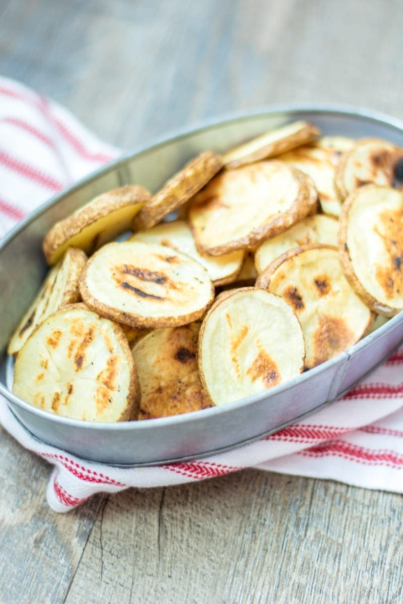 Grilled French Fries: Thin potato rounds, tossed with oil and seasoned to perfection then grilled. These fries are the ultimate side dish. Gluten-Free. Vegan. Easy. Healthy. Low Fat. Side Dish