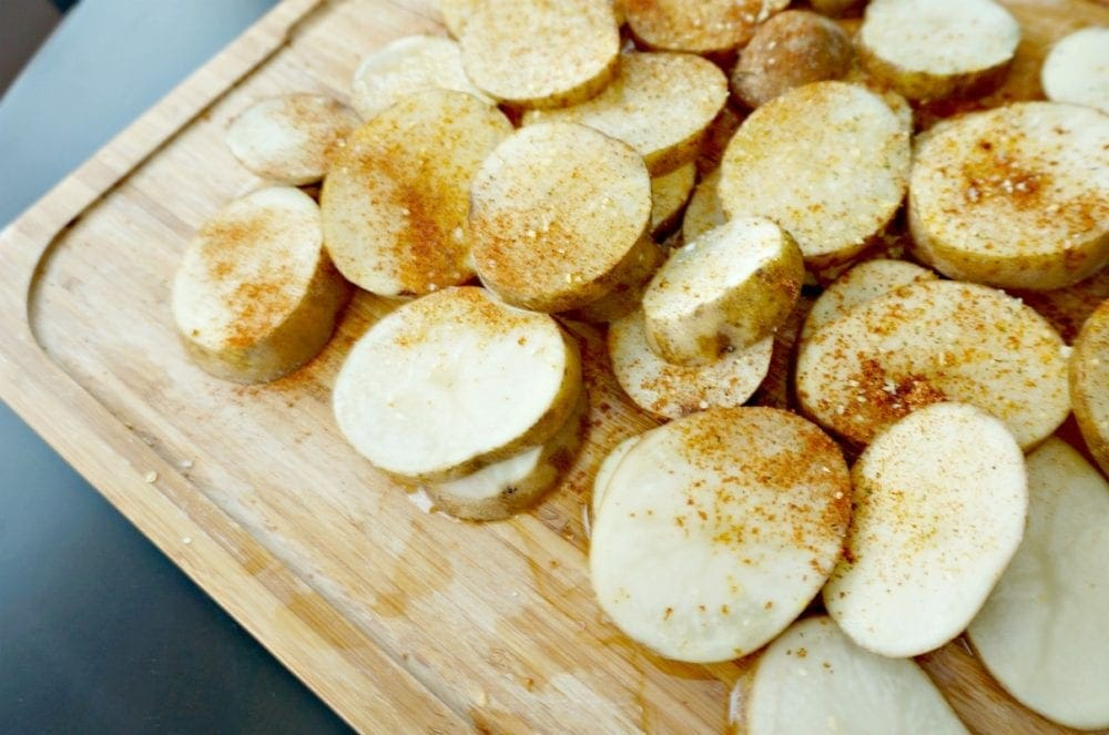 Thin potato rounds have been tossed with oil and seasoned to perfection