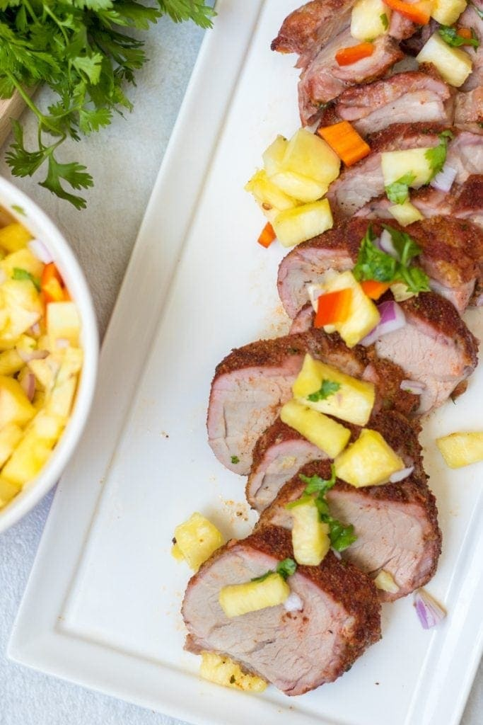 Grilled Pork Tenderloin sliced and topped with Pineapple Salsa