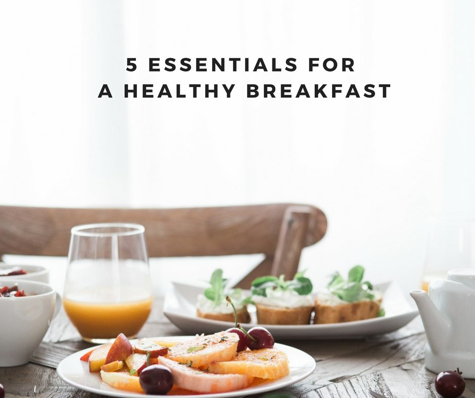 5 Essentials to a Healthy Breakfast: in black text above a table set with breakfast foods.