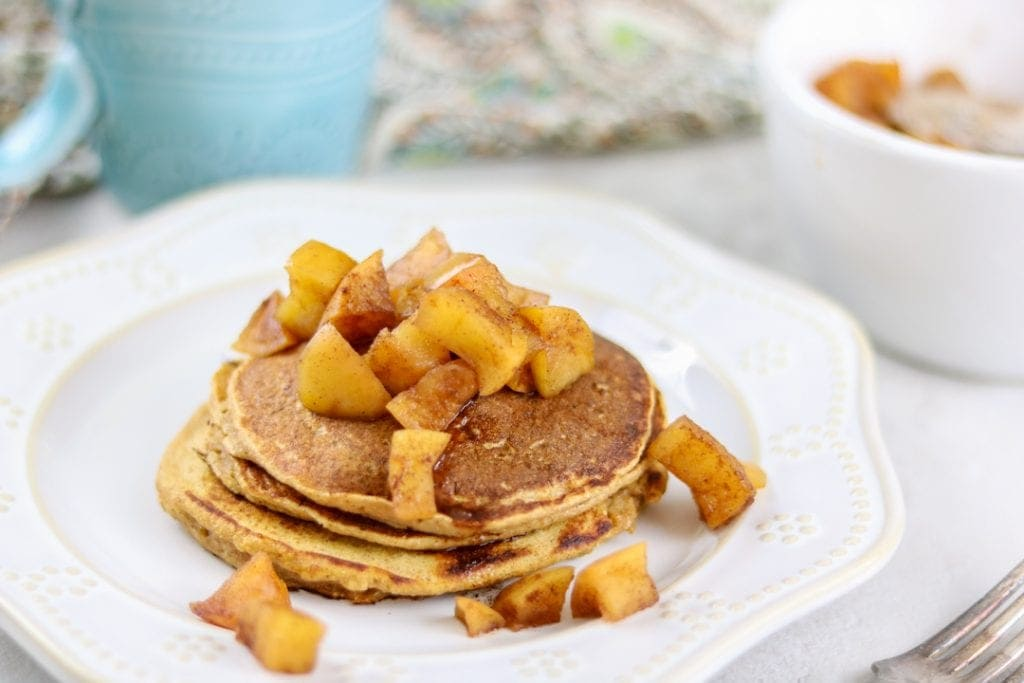 Whole Wheat Sweet Potato Pancakes topped with apples on white plate