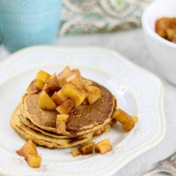 Sweet Potato Pancakes on white plate topped with cinnamon apples