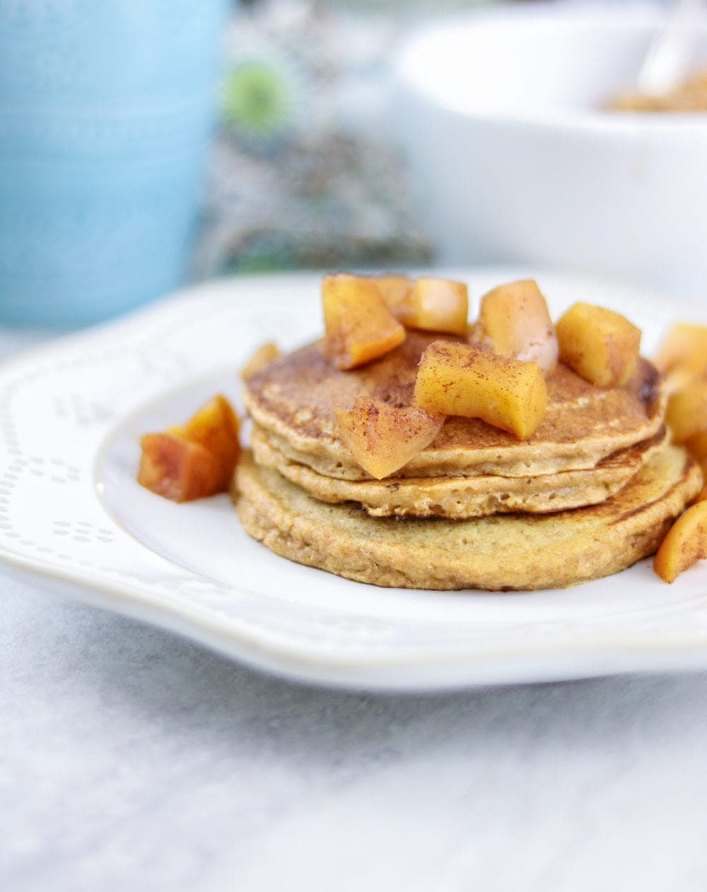 Easy Sweet Potato Pancakes with Cinnamon Apples on white plate