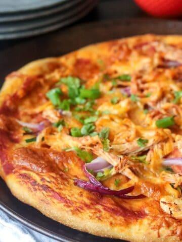 Chicken Fajita pizza topped with cilantro on tray
