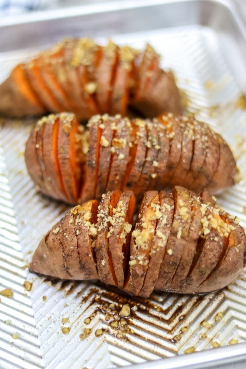 Healthy Hasselback Sweet Potatoes: Roasted sweet potatoes are baked with a fancy streusel of maple, coconut oil and pecans, for an elegant and easy side dish.