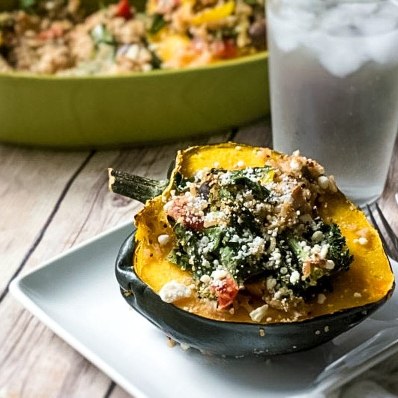 Hearty quinoa that has been studded with the flavors of Mediterranean Cuisine, is stuffed inside tenderly baked acorn squash for a filling gluten free meal that is packed with nutrition.