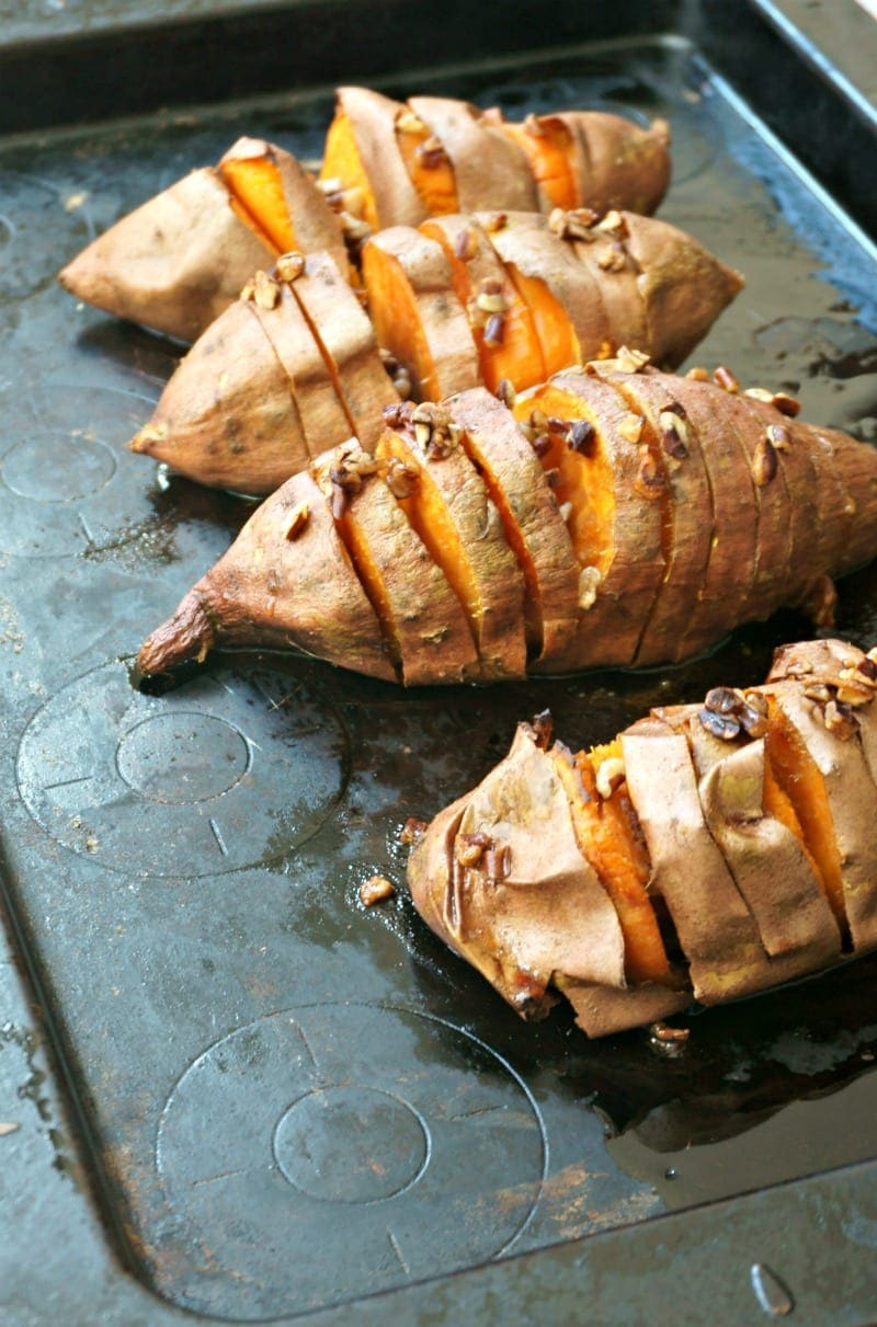 Hasselback Sweet Potatoes: Roasted sweet potatoes are baked with a fancy streusel of maple, coconut oil and pecans, for an elegant and easy side dish.