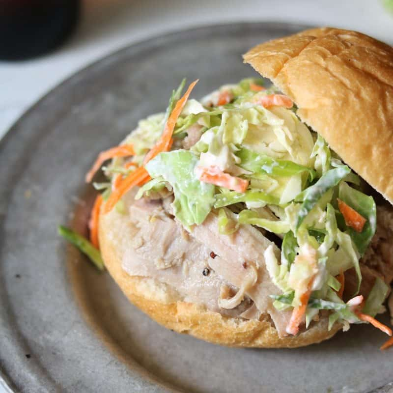 Honey Mustard Pork Sliders with Brussel Sprout Slaw: Warm juicy pork, tangy slaw all piled on a soft bun--a mouthful to say and a mouthful you will want to eat!!