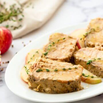 Slow Cooker Apple Pork Loin on white platter