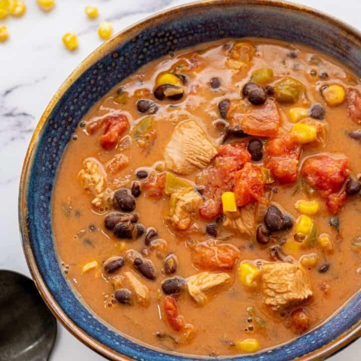 Southwest Turkey Soup in blue bowl.