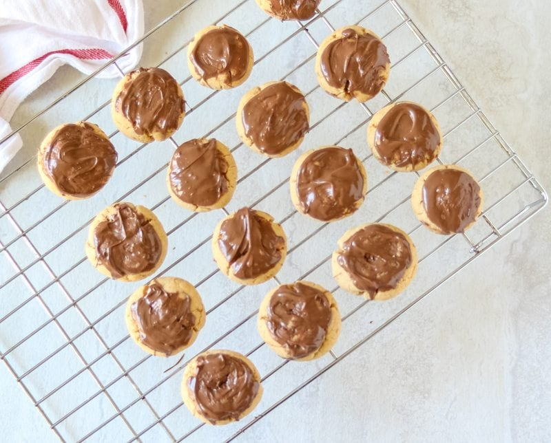 Chocolate Dipped Peanut Butter Cookies on Baking Rack