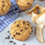 Healthy Banana Muffin next to cooling rack with chocolate chips
