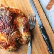 Rotisserie chicken on cutting board