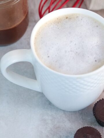 White mug filled with peanut butter latte