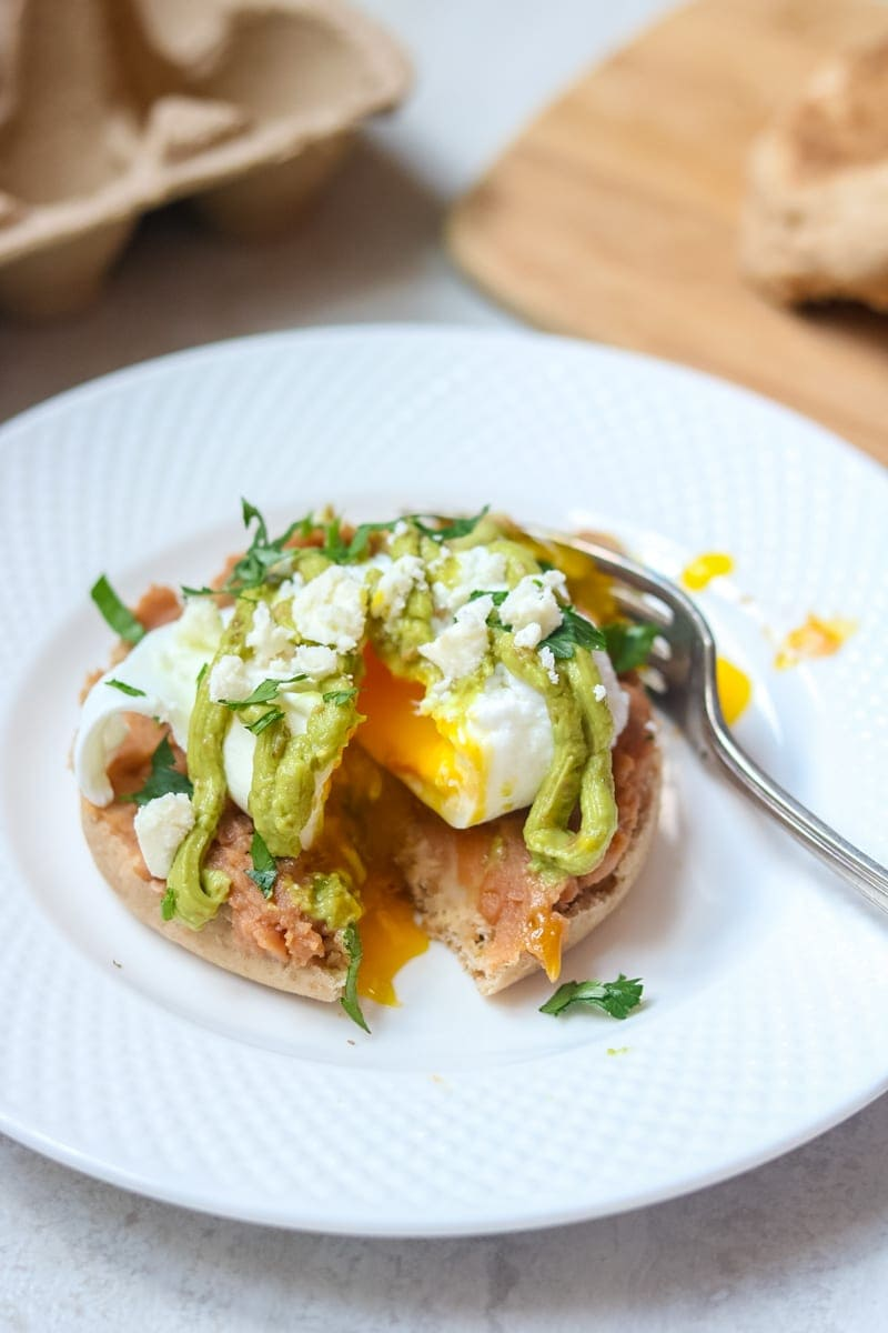Mexican eggs benedict with avocado hollandaise oven poached eggs poached egg on top of english muffin cut open with yolk running out forumfinder Gallery