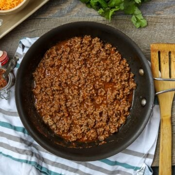 Taco Meat in skillet with wooden spoon