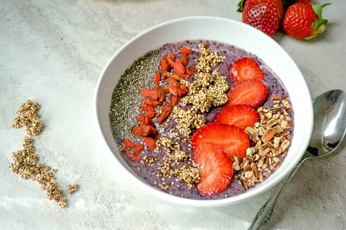 White Bowl with Berry Smoothie topped with berries and chia seeds