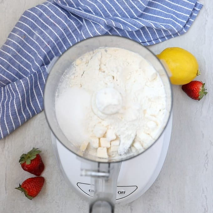 Food Processor with flour, sugar, and butter