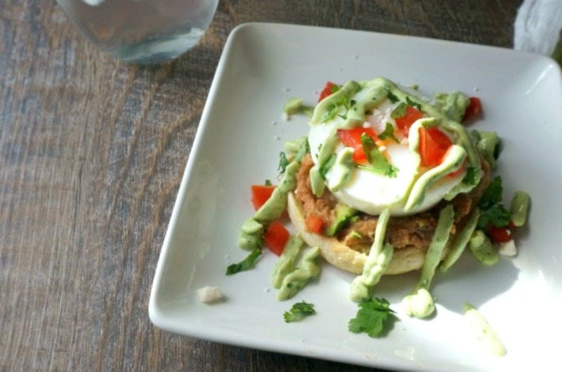 Mexican Eggs Benedict with Avocado Hollandaise: A Mexican spin to a classic. A perfectly poached egg sits upon a spicy refried beans on a toasted muffin and then finished with fresh tomatoes and a creamy Avocado Hollandaise. Served with a Mexican Avocado salad, all made with organic avocadoes from ALDI.
