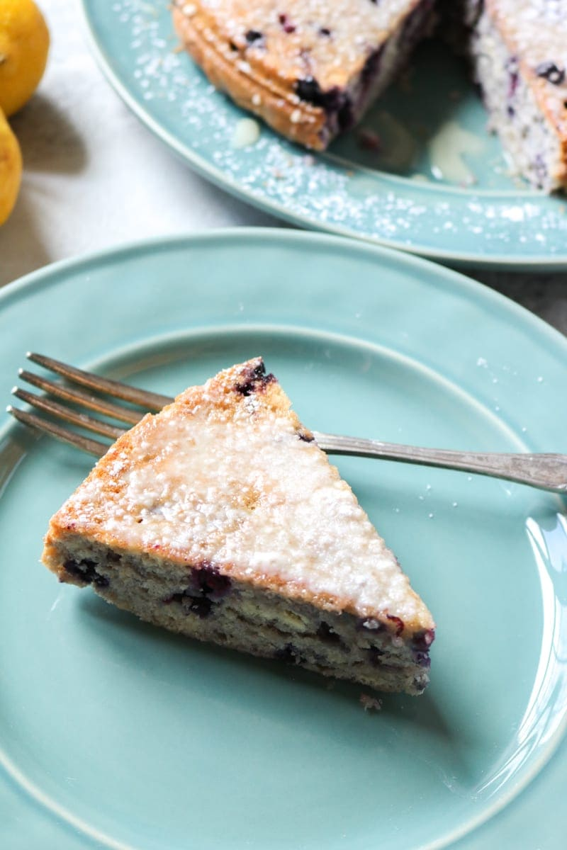 Berry Coffee Cake with Lemon Glaze: A tender, whole wheat cake that is naturally sweetened with a secret ingredient and given a bright taste with the addition of a sweet lemon glaze. This is the perfect healthy addition to any brunch!