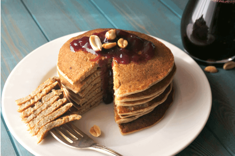 Peanut Butter Pancakes with Jelly Syrup: Fluffy, gluten-free peanut butter pancakes are topped with grape jelly syrup, for a breakfast spin on a classic lunchbox favorite.