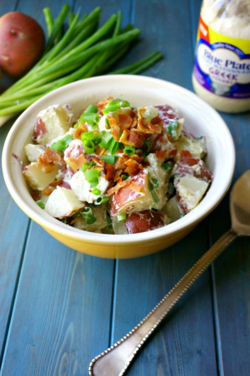 Bacon Ranch Potato Salad: Red potatoes, crispy bacon, sharp scallions, and a homemade Ranch dressing made with Blue Plate® Light Mayonnaise with Greek Yogurt is sure to become your new favorite pot-luck go-to!