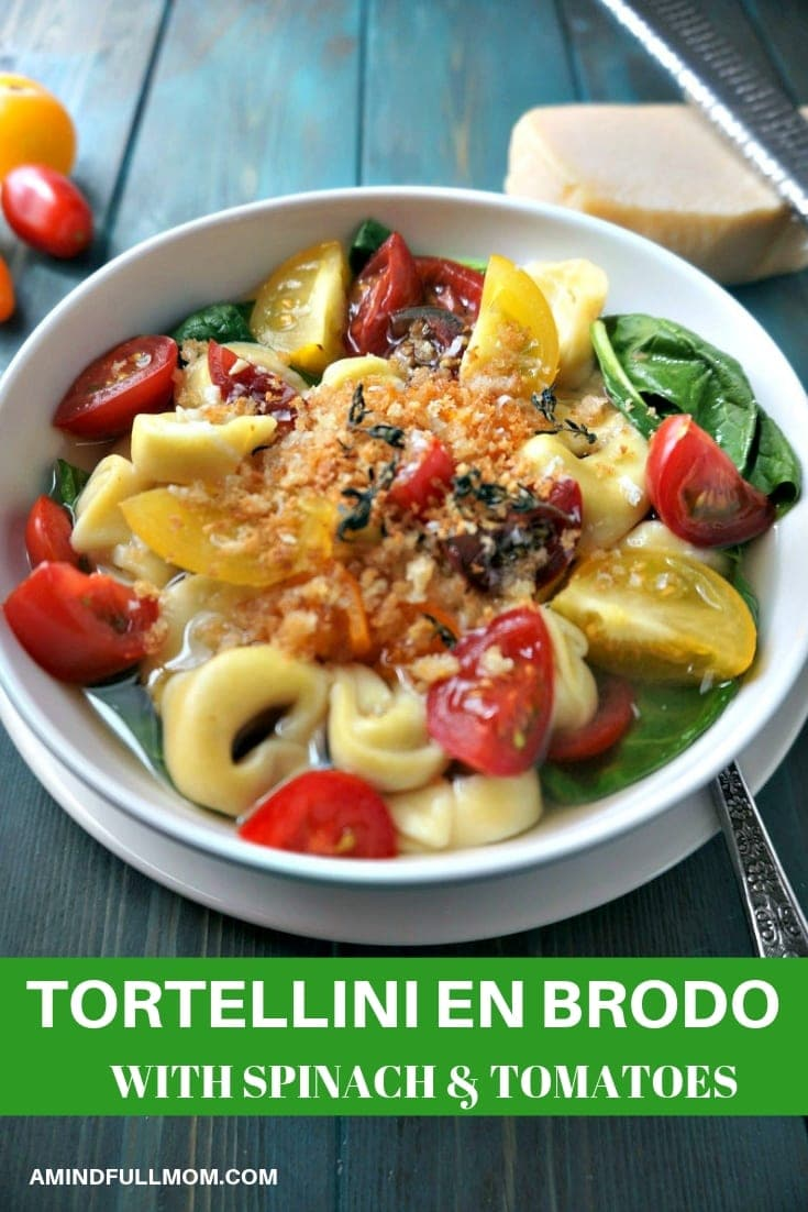 Tortellini en Brodo is a delicious broth bowl made with cheese tortellini in a  rich broth flavored with garlic and thyme. This simple broth bowl recipe is elevated with fresh tomatoes, spinach and topped with a crunchy mixture of toasted bread crumbs and Parmesan cheese. #pasta #italian #Christmas
