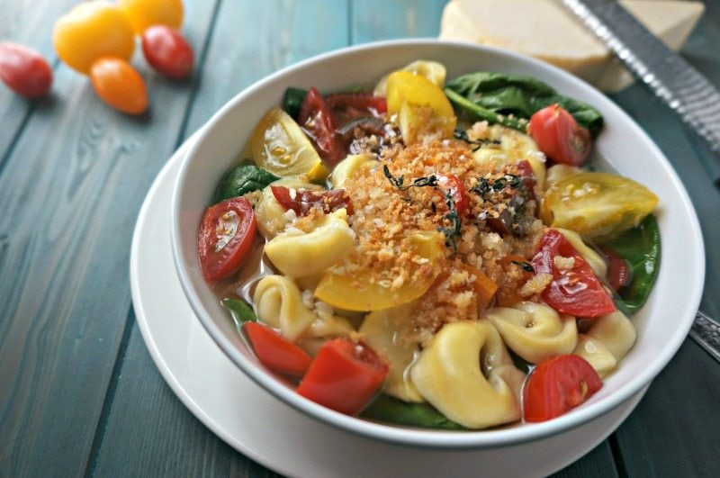 Tomato and Spinach Tortellini Broth Bowl: Fresh tomatoes, spinach, and cheese tortellini are swimming in a light broth flavored with garlic and thyme, topped with a crunchy mixture of toasted bread crumbs and Parmesan cheese.