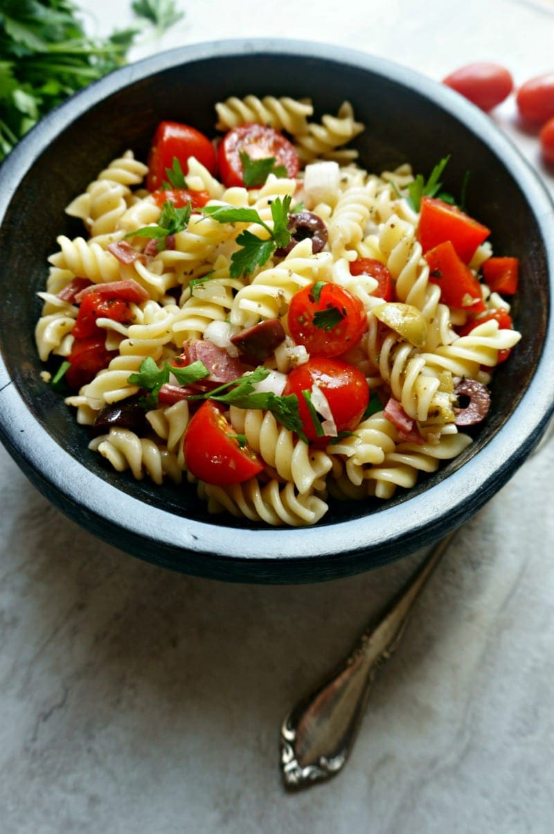 Antipasto Pasta Salad  in large black serving bowl.