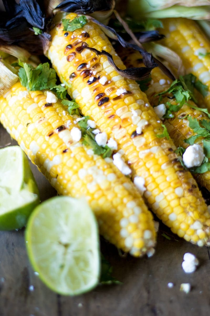 Elote Grilled Corn topped with queso fresco and fresh lime juice