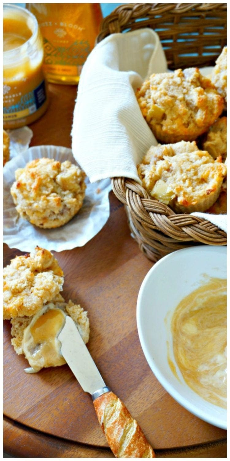 Flaky whole wheat biscuits have been jazzed up with breakfast sausage, sharp cheddar, and fresh apples and turned into muffins. Served with a cinnmon honey butter that takes this breakfast treat over the top.