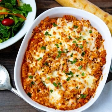 Casserole dish with baked rotini pasta
