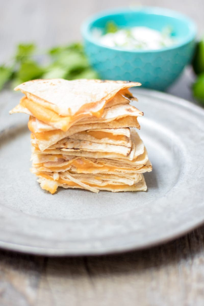 Hidden Veggie Quesadilla--A cheese quesadilla is given a healthy make-over with the addition of a layer of butternut squash puree. Served with Cilantro Lime Cream. It is the perfect way to sneak veggies into your child!
