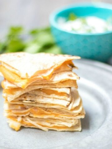 Cheese Quesadilla cut into wedges and stacked on silver plate