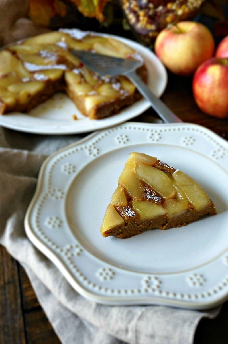 Slice of Pumpkin Cake with Caramelized Apples on white plate