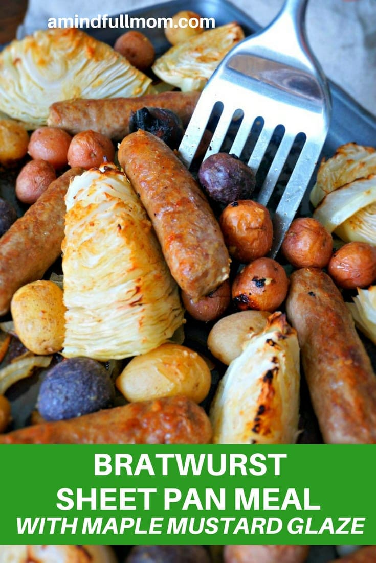 Bratwurst Sheet Pan Dinner: Bratwurst, potatoes, onions, and cabbage are roasted with a mustard maple vinaigrette for an easy, flavorful one pan meal.#oktoberfest #sausage #onepanmeal #sheetpanmeal #germanrecipe #glutenfree