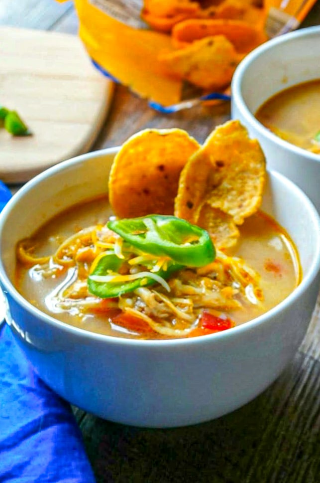Slow Cooker King Ranch Chicken Soup is a slow cooker soup that is creamy, spicy, and hearty. This Tex-Mex chicken soup is a delicious meal for your family to enjoy.