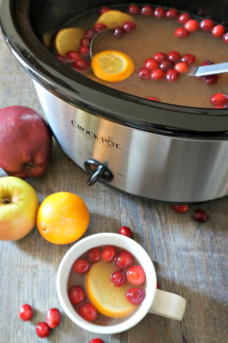 Slow Cooker Mulled Cider: Apple cider is mulled with pineapple juice, fresh oranges, fresh cranberries and spices in the slow cooker.