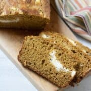 Sliced Pumpkin Bread with Cream Cheese Swirl on Cutting Board