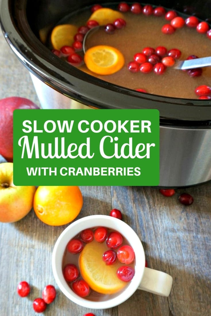 Slow Cooker Mulled Cider: Apple juice, pineapple juice, fresh oranges, and cranberries are spiced with cinnamon, ginger, and nutmeg and simmered together in the slow cooker for a warming, yet refreshing Cranberry Apple Cider. #fall #thanksgiving #christmas #cider #applecider