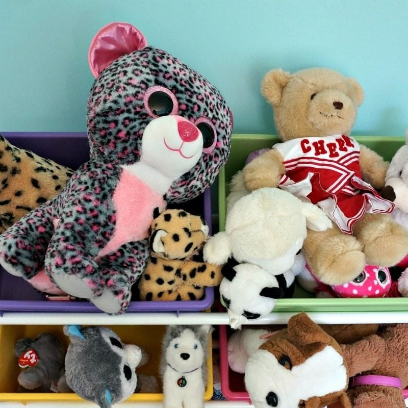 stuffed animals in bin