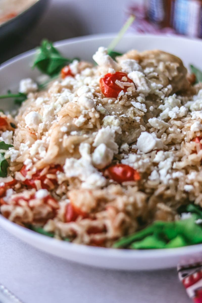 Chicken and Rice Skillet with Feta, tomatoes, argula and garlic.