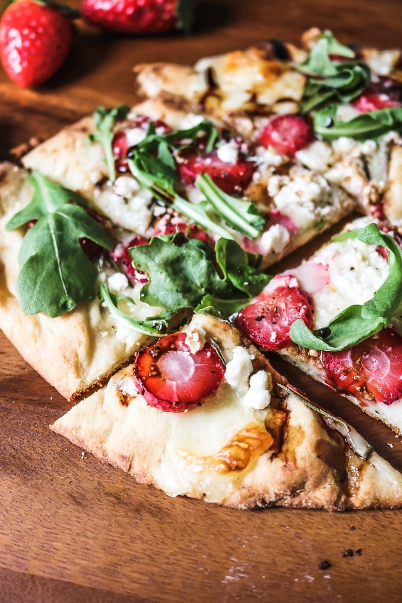 This Strawberry Pizza with Arugula is a savory, unique flatbread pizza. A cheese pizza is brought to life with subtle sweetness from strawberries, sharpness from arugula, and a rich balsamic drizzle. It is a pizza like you have never had and will always remember!