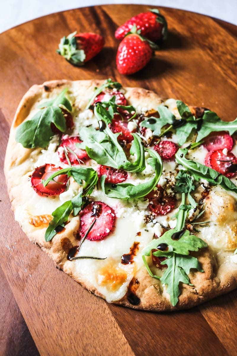 Strawberry Balsamic Pizza on wooden cutting board