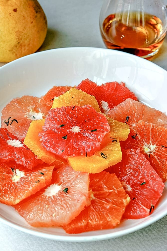 Bowl of Citrus Salad with Maple Syrup in background