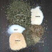 Spices for ranch seasoning on wooden board labeled with black text overlay