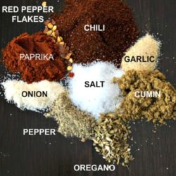 Spice for taco seasoning on wooden board