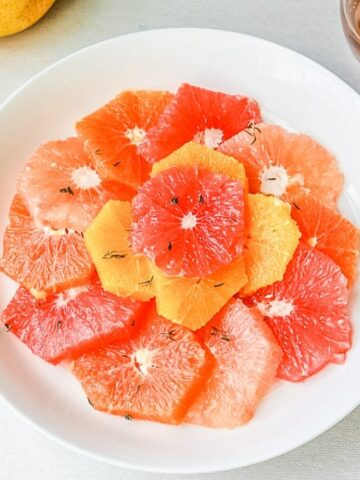 Bowl of winter citrus fruit with thyme syrup